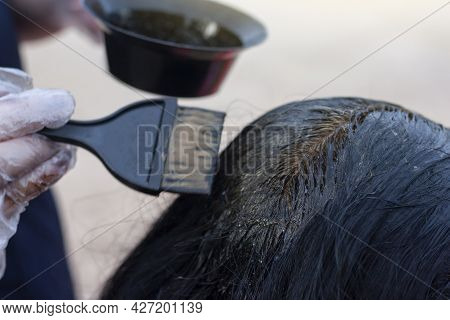 Dyed Gray Hair Into Black With Chemicals For Dyeing Hair.