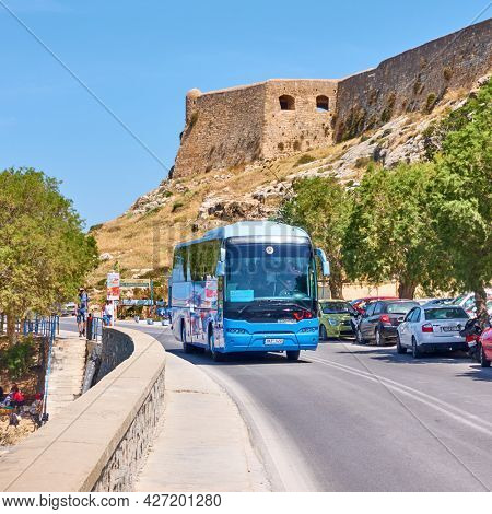 Rethimno, Crete Island, Greece - April 26, 2018: Tourist bus on the road in Rethimno