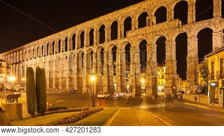 Segovia, Spain - September 21, 2015: Ancient roman aqueduct in Segovia at night. Cityscape, panoramic view