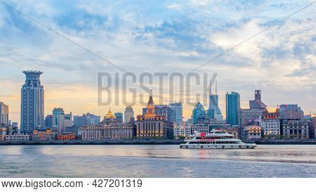 Shanghai, China - April 10, 2014: Shanghai city with The Bund waterfront and river at twilight. Panoramic view