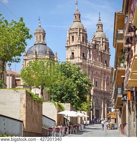Salamanca, Spain - September 3, 2016: Old street in Salamanca with La Clerecia Church