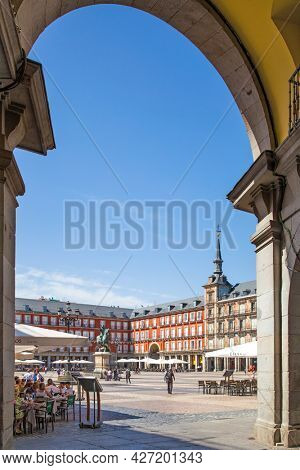 Madrid, Spain - September 6, 2016: Plaza Mayor in Madrid through gate arch