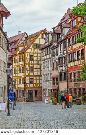 Nuremberg, Germany - May 17, 2016:  Street in the old town of Nuremberg with half-timbered houses