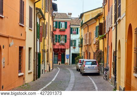 Cesena, Italy -  February 27, 2020: Street with colorful old dwelling houses in Cesena, Emilia-Romagna. Italian cityscape