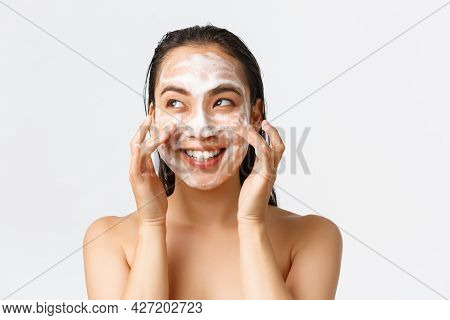 Skincare, Women Beauty, Hygiene And Personal Care Concept. Happy Cheerful Pretty Asian Girl Standing
