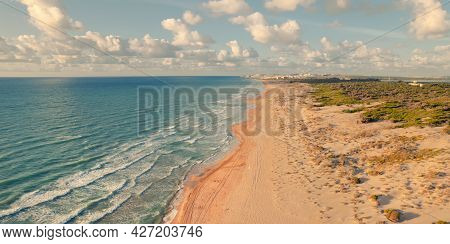 Aerial Drone Point Of View Sandy Beach Of La Mata And Mediterranean Sea In The Early Morning. Costa