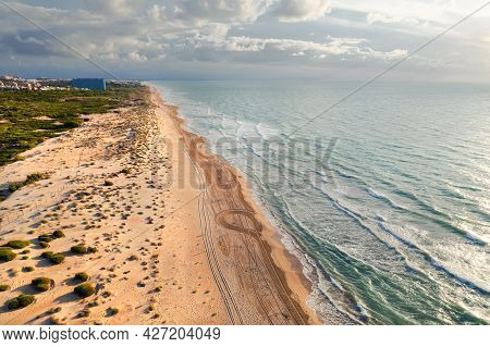 Aerial Drone Point Of View Sandy Beach And Mediterranean Sea In The Early Morning. El Moncayo, Guard