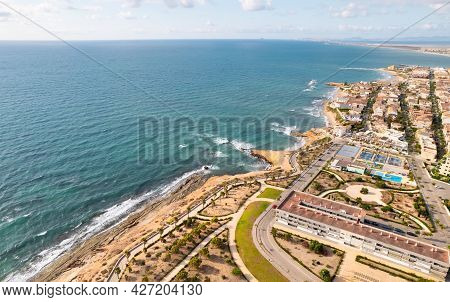 Aerial Drone Point Of View Empty Beach Of Mil Palmeras Campoamor At Early Morning. Isyllic Scenery,