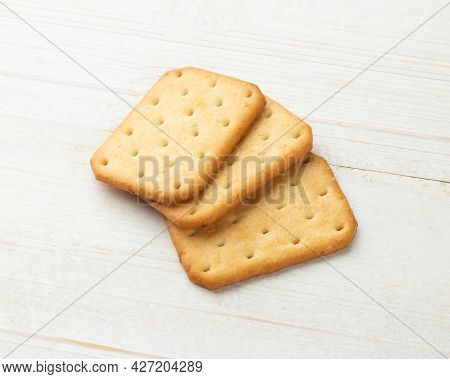 Cracker Cookies On White Wooden Table Background.