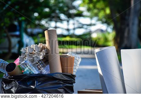 Garbage In Black Bag With Blur Background Garbage In Black Plastic Bag With Blur Background