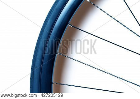 New Road Bike Wheel With Tire And Spokes Isolated On White Background