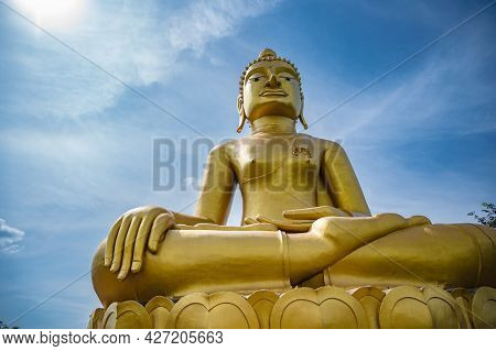 Golden Big Buddha On Phu Chang Noi  At Chiang Khan Loei Thailad.chiang Khan Is An Old Town And A Ver