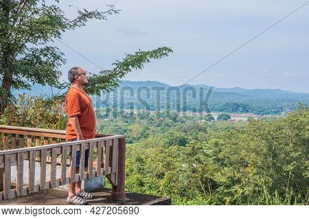 Asia Fat Guy With Landscape View On Phu Chang Noi Chiang Khan District Loei City Thailand.chiang Kha