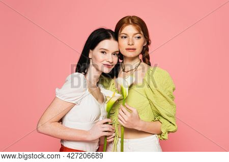 Women With Freckles And Vitiligo Holding Flowers Isolated On Pink