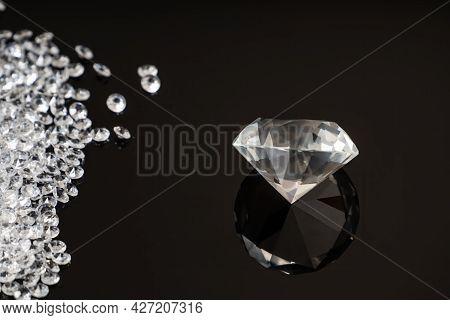 Brilliant Or Diamond Gem On Black Background.