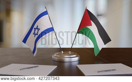 Israel And Palestine Flags On Table. Negotiation In Conflict Concept. 3d Rendered Illustration.