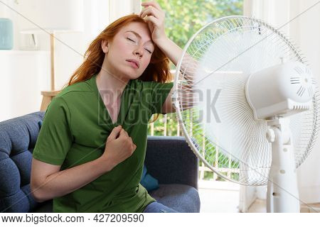 One Woman Suffering For Summer Heatwave At Home