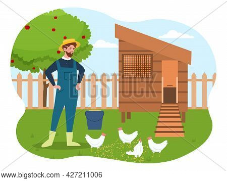 Chicken Coop Concept. A Young Male Farmer Feeds Chickens With Millet Near Their House. Taking Care O