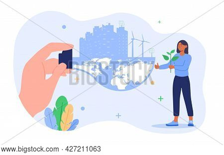 City Bio Resources Concept. Hand Holds A Light Bulb With A Planet And City. Obtaining Electricity Fr