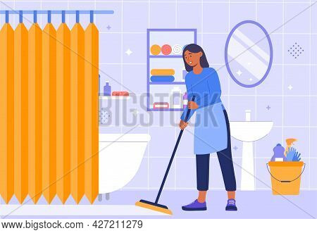 Cleaning Bathroom Concept. Woman With A Mop In Her Hands Cleans The Bathroom Floor. Disinfection Of