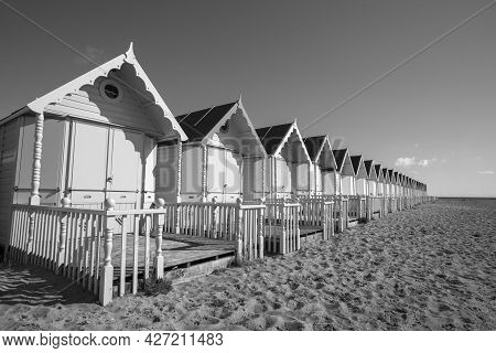 Black And White Image Of The Beach Huts At West Mersea, Essex, England