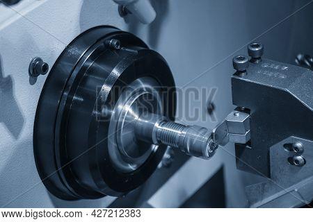 The  Multi-tasking Cnc Lathe Machine Slot Cutting The Metal Shaft Parts. The Hi-technology Metal Wor