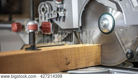 Circular Saw Miter Saw Photographed In The Workshop Atmosphere.