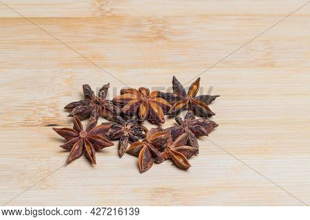 Star Anise Star Anise On A Wooden Board.