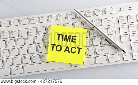Text Time To Act On The Keyboard On White Background