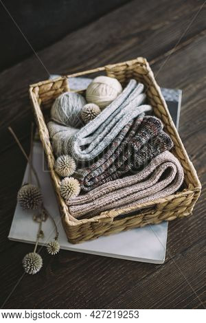 Hand Knitting Socks With Yarn Balls In A Basket On A Dark Wooden Background.  Concept For Handmade A