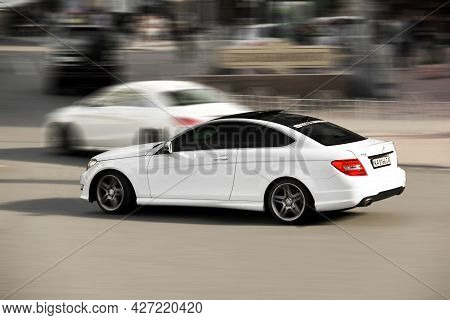 Kiev, Ukraine - May 22, 2021: White Mercedes-benz C250 Coupe In Motion