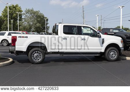 Plainfield - Circa July 2021: Ford F250 Super Duty Display At A Dealership. The Ford F-250 Is Availa