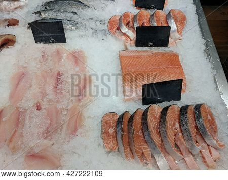 Few Raw Fresh Steaks And Fillet Of Red Fish On Ice With Empty Price Tags At Fish Market Or Local Sto