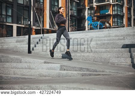 Pleased Athlete Running In A New Residential District