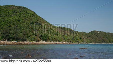 Sea and blue sky with mountain island