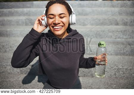 Young Female Grooving On Her Favorite Music