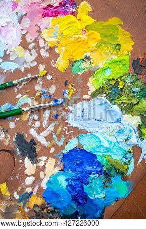 Palette With Multi-colored Paints And Brushes, Woman Painting Picture