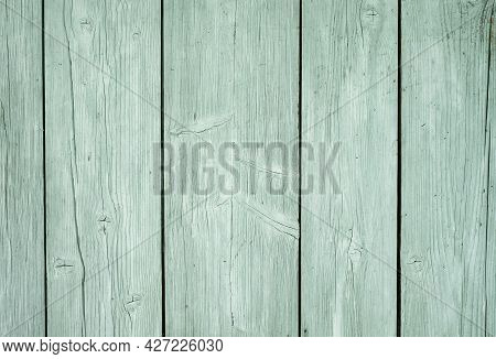 An Old Wooden Floor With Boards And A Natural Wood Texture, Painted With A Light Mint Color Paint. W