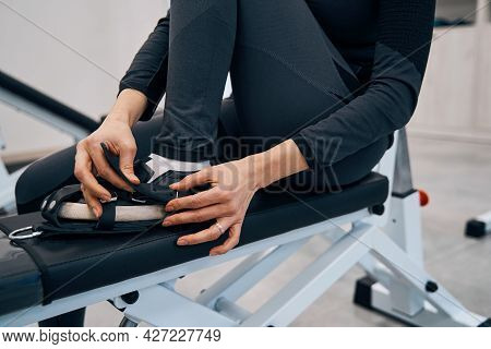 Closeup Of Young Lady Wears Special Rehab Shoes On Her Feet To Practice On Recreational Simulator