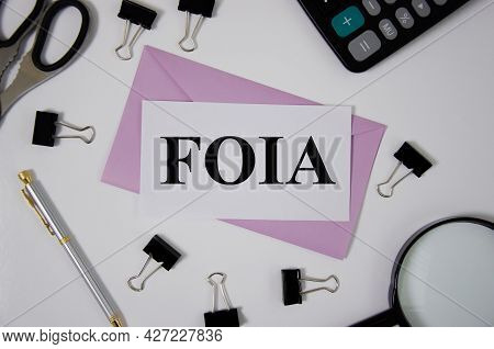 Foia Concept Word Written On Pink Envelope Near Office Suppliesr