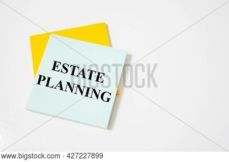 Estate Planning - Business Concept Text Written On A White Notepad With Colored Pencils And A Yellow