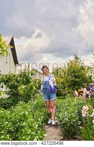 Female Person Standing With Special Tool For Flowerbed
