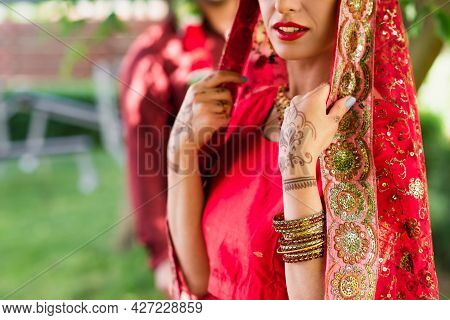 Cropped View Of Indian Bride In Sari And Headscarf Near Blurred Man On Background