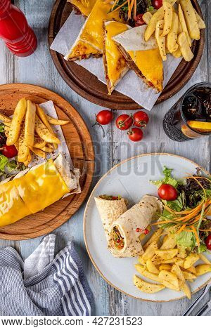 Cheddar Cheese Burrito, Wrap And Quesadilla With French Fries And Salad.