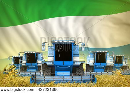 Some Blue Farming Combine Harvesters On Rural Field With Sierra Leone Flag Background - Front View,
