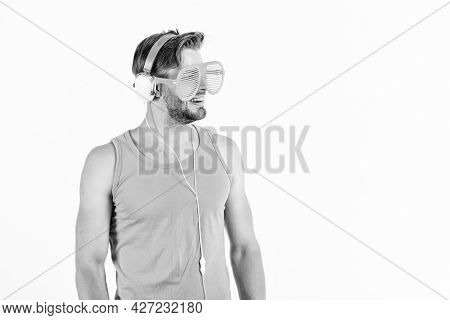 Technology And Entertainment. Modern Life. Handsome Man With Headphones And Sunglasses. Party Concep