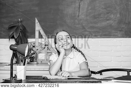 Hooked On Learning. Girl Cute Child Sit School Classroom Chalkboard Background. Small Kid Study Scho