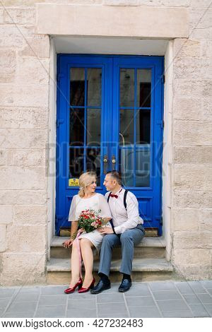 Lovely Date On The Street. Happy Mature Loving Couple, Handsome Man With His Charming Wife In White