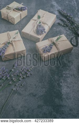 Craft Gift Boxes Decorated With Lavender. On A Concrete Background. Space For Text. Eco Concept. Top