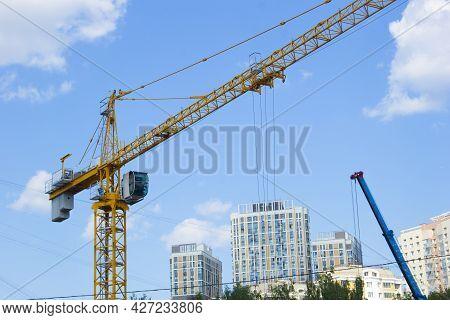 Lifting Crane. Crane Work On The Construction Site.